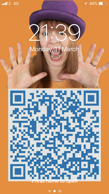 Lock screen designed using Canva featuring a QR code on the bottom half of the screen